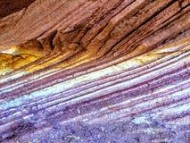 Sandsten varvar färgrikt bakgrundsabstrakt begrepp för closeupen Royaltyfri Foto