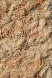 Sandstone. Fragment of a wall from sandstone Royalty Free Stock Photos