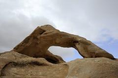 Sandstone arch in Jordan desert. Royalty Free Stock Photo