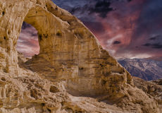 Sandstone arch at sunset in geological Timna park Royalty Free Stock Images