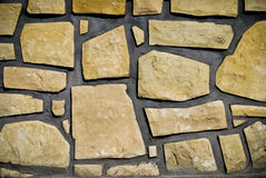 Sandstone background. Closeup of wall with sandstones royalty free stock image