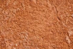 Sandstone Background/Texture. A mottled and cracked sandstone surface useful for background/texture Royalty Free Stock Images