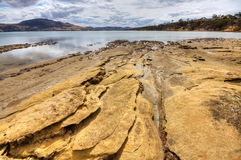 Sandstone beach Stock Image