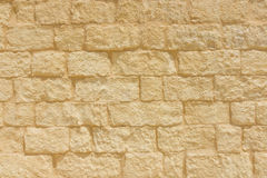 Sandstone brick wall background. Stock Image
