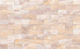 Sandstone brick wall patterned (natural patterns) texture background. Stock Photos
