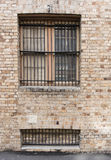 Sandstone brick wall with two windows Stock Photos