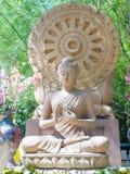 Sandstone Buddha image sitting front Dharmacakra Stock Photos