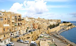 Sandstone buildings in  the old harbor and Victoria Gate in Valetta Stock Images