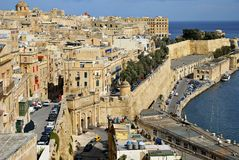 Sandstone buildings in  the old harbor and Victoria Gate in Valetta Royalty Free Stock Photo