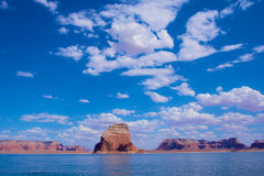 Sandstone Butte in Blue Water Royalty Free Stock Photo