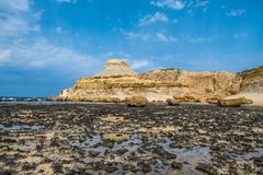 Sandstone butte of Salt Pans, Xwejni Bay, Xwejni, Gozo Island, Malta. Europe Royalty Free Stock Images