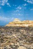 Sandstone butte of Xwejni Bay, Xwejni, Gozo Island, Malta,. Europe with beach on the foreground Stock Photography