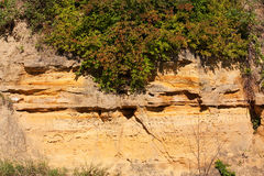 Sandstone cliff face with carvings. The side of a cliff with various carvings Royalty Free Stock Photography