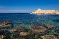 Sandstone cliffs above the Xwejni Bay. On Maltese island Gozo Stock Image