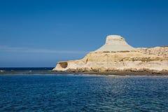 Sandstone cliffs above the Xwejni Bay. On Maltese island Gozo Stock Photos