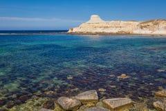 Sandstone cliffs above the Xwejni Bay. On Maltese island Gozo Royalty Free Stock Image