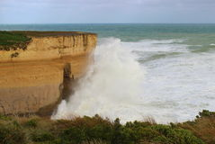 Sandstone cliffs with big waveson Great Ocean Road. Sandstone cliffs with big waves after hurricane on Great Ocean Road in Australia Stock Photo
