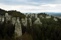 Sandstone Cliffs in Bohemian Paradise. A Pile of Cut Tree Trunks in Sedmihorky, Bohemian Paradise, Czech republic royalty free stock photos