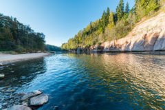 Sandstone cliffs in Gauja national park. Sandstone cliffs by the river in Gauja national park in latvia royalty free stock photography