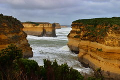 Sandstone cliffs on Great Ocean Road. Sandstone cliffs with big waves after hurricane on Great Ocean Road in Australia Royalty Free Stock Photography