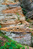 Sandstone cliffs with inscriptions Stock Photography