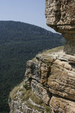 The sandstone cliffs in mountains on the sunny day. Royalty Free Stock Photos