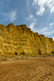 Sandstone Cliffs of West Bay. Steep Cliffs of West Bay, film location of Broadchurch. Dorset, England, United Kingdom royalty free stock image