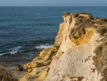 Sandstone coastline with sandy beaches at Gale. On the southern coast of Portugal Royalty Free Stock Photo