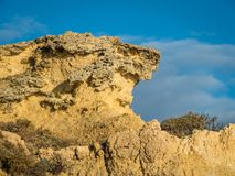 Sandstone coastline with sandy beaches at Gale. On the southern coast of Portugal Stock Photos