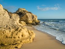 Sandstone coastline with sandy beaches at Gale. On the southern coast of Portugal Stock Images