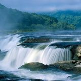 Sandstone Falls in fog Royalty Free Stock Photography