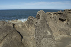 Sandstone Formations at Shore Acres State Park, Oregon. Interesting pitted sandstone formations at Shore Acres State Park on the Oregon Coast Royalty Free Stock Photos