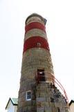 Sandstone lighthouse isolated on white background Royalty Free Stock Image