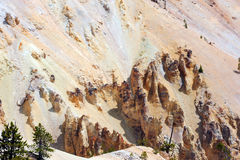 Sandstone Monoliths. Rugged canyon walls and sandstone monoliths form this part of the view of the Grand Canyon of the Yellowstone, in Yellowstone National Park royalty free stock photography