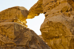 Sandstone natural bridge in the Wadi Rum Stock Photo