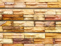 Sandstone pattern. A photo of sandstone pattern. The sandstone bricks seamless of house wall. Pattern continuous replication for texture and background stock images