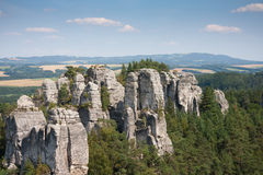 Sandstone pillars in the Czech republic. Sandstone pillars arising above the wood in the bohemian paradise of the Czech republic stock photography