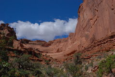 Sandstone Ridge. Arches National Park, clouds roll in over huge rock wall Royalty Free Stock Photos