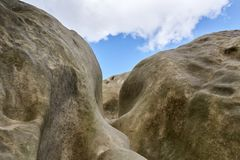 Sandstone rock formation against sky with clouds Stock Photography