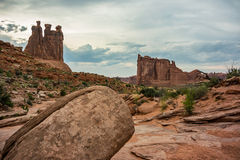 Sandstone Rock with Gossips and Coutrhouse Stock Photo