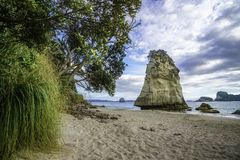 Sandstone Rock Monolith Behind Stones In The Sand At Cathedral C Stock Images