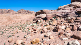 Sandstone rocks in desert landscape in Petra town. Travel to Middle East country Kingdom of Jordan - sandstone rocks in desert landscape in Petra town Royalty Free Stock Photography