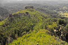 Sandstone rocks. Landscape of the Bohemian Switzerland with sandstone rocks in the forest on the top of the hill stock photos