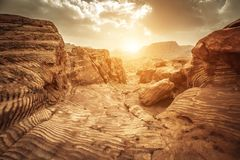Sandstone rocks in petra. Detail of sandstone rocks in the light of sunset, path of the Nabataeans, picturesque landscape located in Petra, Jordan royalty free stock photography