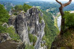 Sandstone rocks in the `Saxon Switzerland` with the Elbe in the background royalty free stock image
