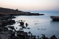 Sandstone rocks at a sea. Sandstone rocks at the sea shore Royalty Free Stock Photo