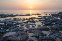 Sandstone rocks at the sea on sunrise. Sandstone rocks at the sea on beautiful sunrise Stock Images