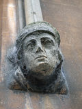 Sandstone Sculpted Female Head on Building Wall Stock Photos
