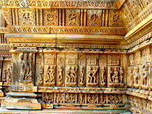 Sandstone Sculptures. Idols of Indian Gods on a temple wall made of yellow sandstone, in Udaipur, Rajastan, India Stock Image
