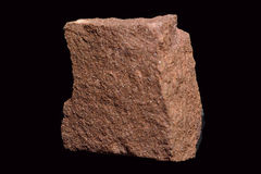 Sandstone. Sedimentary rock, varying in color. Shows appearance of grains of sand accumulation Stock Photo